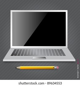 Computer notebook and pencil on gray background