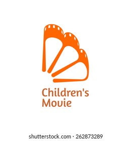 Concept of a Children's Movie icon. The movie film in a shape of an orange. Vector.