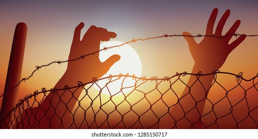 Concept of desperation of refugees fleeing war in their country trying to cross the barbed wire of a border