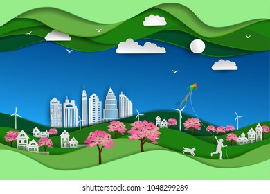 Concept of eco friendly and save the environment with green nature landscape paper art scene background,Happy child playing kite in the sakura park with dog