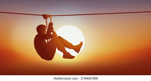 Concept of leisure and outdoor activities with a man looking for thrills on the zip line of a tree climbing course.