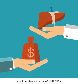 Concept of organ transplant. Buying liver. Hand holding human liver, buyer holding money.