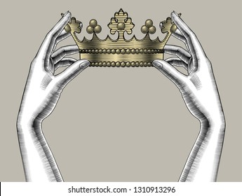 Concept of power and strength. Female hands holding a gold crown. Vintage engraving stylized drawing. Vector illustration