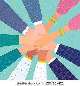 Concept of team work. Friends with stack of hands showing unity and teamwork, top view. People putting their hands together. International team building group of different race business partners