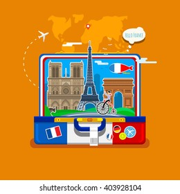 Concept of travel to France or studying French. French flag with landmarks in open suitcase.