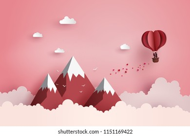 concept of valentine's day and wedding ,couple in love hugging in a basket of heart hot air balloon fly over the mountain, paper art and digital craft.