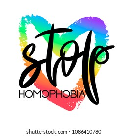 Conceptual poster with hand lettering. Black handwritten phrase Stop Homophobia and colorful LGBT rainbow heart shape isolated on white. Vector typographic illustration for gay community support