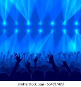 Concert crowd with raised hands silhouettes at a party in nightclub - concept of a disco lights background