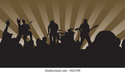 Concert silhouette showing the four piece band and crowd rockin out.