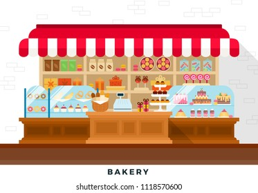 Confectionery store with cakes, sweets, croissants, coffee, tea, gift boxes, donuts, lollipops, macaroons and baguettes in the basket behind a wooden counter against a white wall