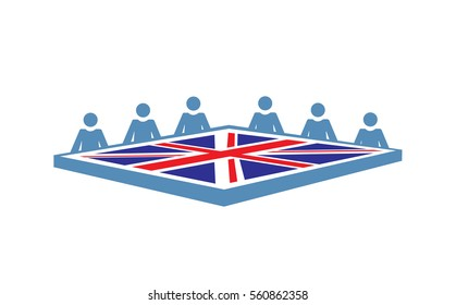 A conference table with people and the British flag