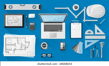Construction engineer desktop with work tools, tablet and laptop