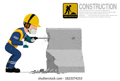 A construction worker is using jack hammer  for demolishing the concrete barrier.