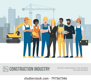 Construction workers and engineers posing together at the construction site, machinery and crane on the background
