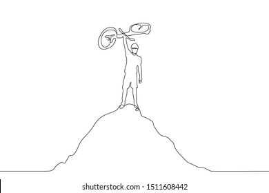 A continuous line drawing of a cyclist standing on top of a mountain and holding his bike as a sign of triumph. The concept of victory, completion, result of labor. It can be used for animation.