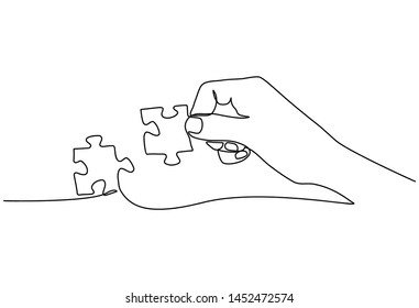 Continuous line drawing of hands solving Two Puzzle Pieces isolated on white background.