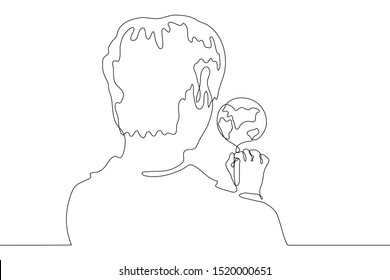 continuous line drawing man draws the earth. Portrait of a young man standing with his back to the viewer. Over the shoulder we see a drawing of the planet earth. It can be used for animation. Vector