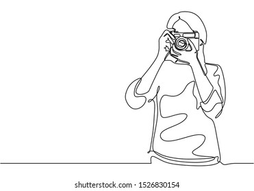 Continuous one line drawing of girl taking picture with camera.