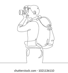 Continuous single one drawn line of the character tourist photographer with camera and backpack