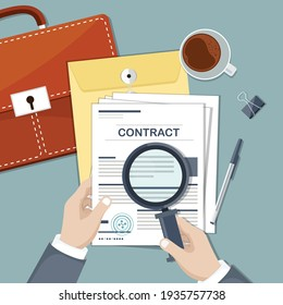 Contract with stamp. Contract inspection concept. Businessman hands holding magnifying glass over a contract.  Research documents.