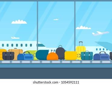 Conveyor belt in airport hall. Baggage claim. Planes outside the window