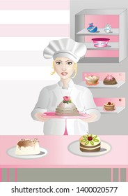 Cook shows a cake in a pastry shop. Blond smiling cook in a big cap holds a richly decorated cake. There are other pastries and dishes on the table and in the cupboard.