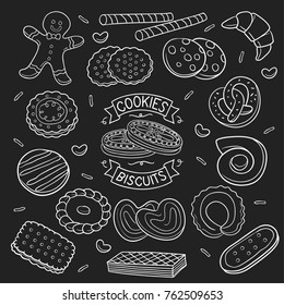 Cookies and biscuit hand drawn on a chalkboard, white color isolated over black background