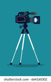 Cool vector flat design video camera on tripod, isolated