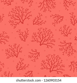 Coral seamless pattern.Tropical reef. Corals on pink background with air bubbles. Vector seamless design for fabric, wallpaper, home textile, packaging and paper for art and craft. Marine collection.