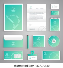 Corporate identity branding template. Abstract vector stationery design with heart illustration symbol on green background. Business documentation