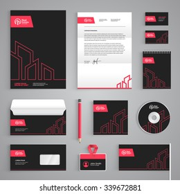 Corporate identity branding template. Real Estate vector stationery design with building logo icon on dark gray background. Business documentation