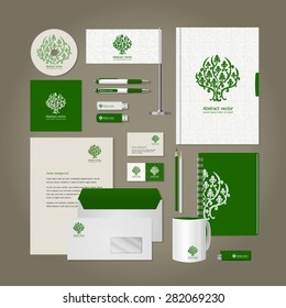 Corporate style - tree. Business cards, a disk, a flag, the handle, a flash card, the form, an envelope, a mug, a notebook, a pencil. Vector.