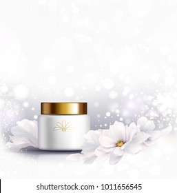 Cosmetic bottle for natural cream. White jar and gold glossy lid with white beautiful Magnolias on the light gray background for ads.