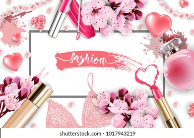 Cosmetics and fashion background with make up artist objects: lip gloss, perfume,pink pearl beads, sparkling hearts. Foundation, pink lipstick. with cherry flowers. Spring and Valentines day Concept.