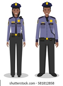 Couple of african american policeman and policewoman standing together on white background in flat style. Police USA concept. Flat design people characters. Vector illustration