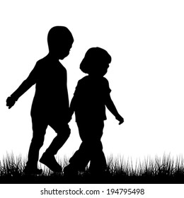 Couple of children silhouettes outdoor