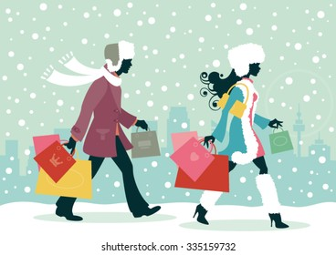 Couple Christmas shopping - Man and woman with shopping bags in the snowy city
