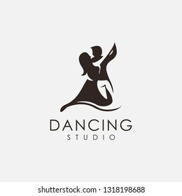 Couple dancing studio logo vector icon template on white background