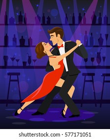 Couple dancing tango in a disco club bar under the spot lights