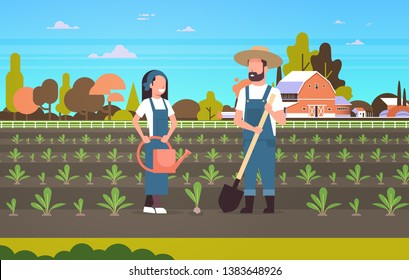 couple farmers planting seedlings plants vegetables man woman gardeners using shovel and watering can agricultural workers eco farming concept farmland countryside landscape horizontal