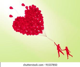 couple holding heart shape balloon