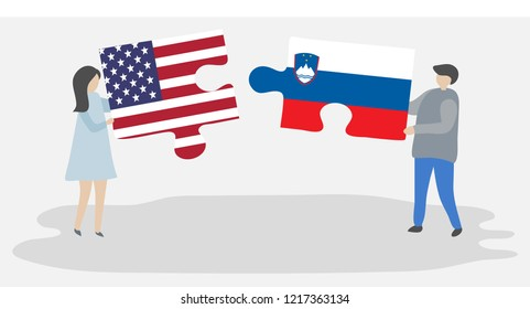 Couple holding puzzle pieces with American and Slovenian flags. United states of America and Slovenia flags together.