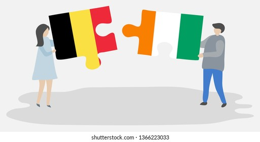 Couple holding two puzzles pieces with Belgian and Ivorian flags. Belgium and Ivory Coast national symbols together.