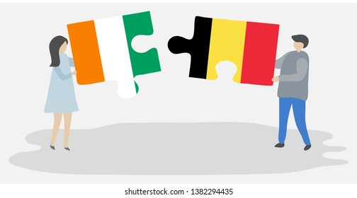 Couple holding two puzzles pieces with Ivorian and Belgian flags. Ivory Coast and Belgium national symbols together.