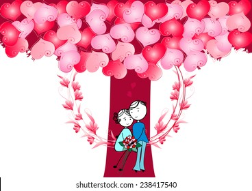 Couple in love.Boy and girl sitting on a swing with heart tree
