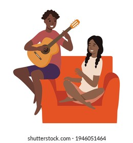 Couple, love, play, romance, music, recreation concept. Romantic man and woman senior citizens pensioners sitting on couch together and playing guitar musical instrument at home. Happy retirement.