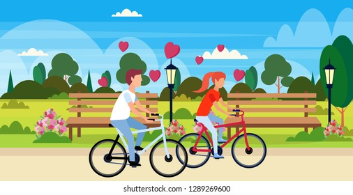 couple in love riding bicycles happy valentines day holiday concept city urban park landscape young man woman lovers cycling bike horizontal flat