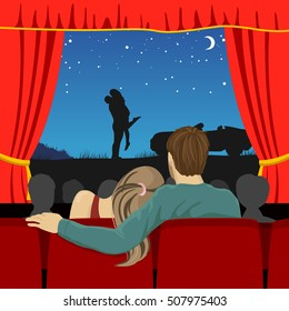 couple of lovers watching romantic movie in cinema theater