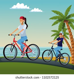 Couple riding bikes at beach