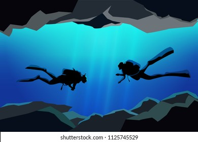 couple of scuba divers in the caves ,rescue team